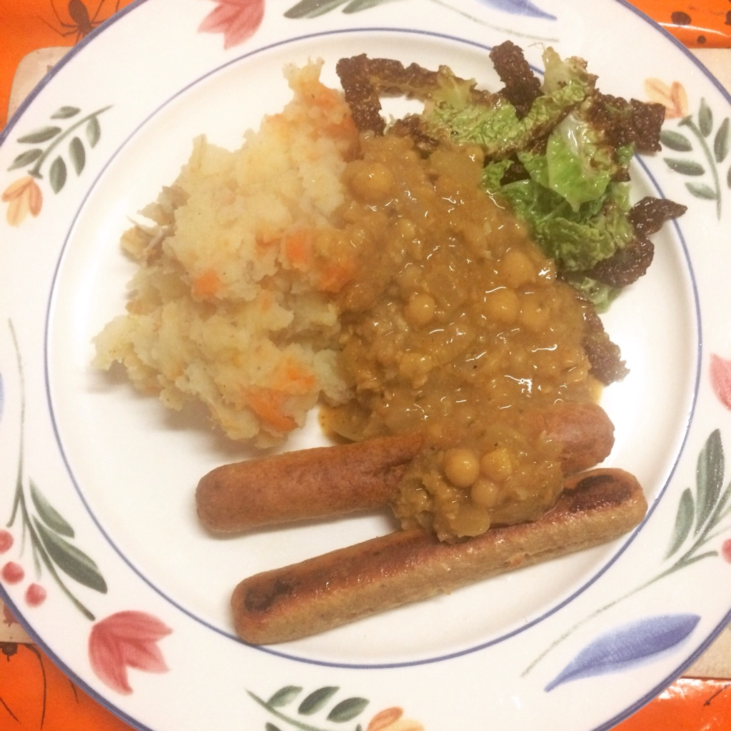 Vegan dinner with sausages, fried cabbage, punk rock chickpea gravy and 'clapshot' midorigreen.co,U.K.